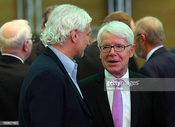 Bayer Leverkusen sports director Rudi Voeller talks to DFL league president Reinhard Rauball during DFB Bundestag Day 2 at NCC Nuremberg on October...