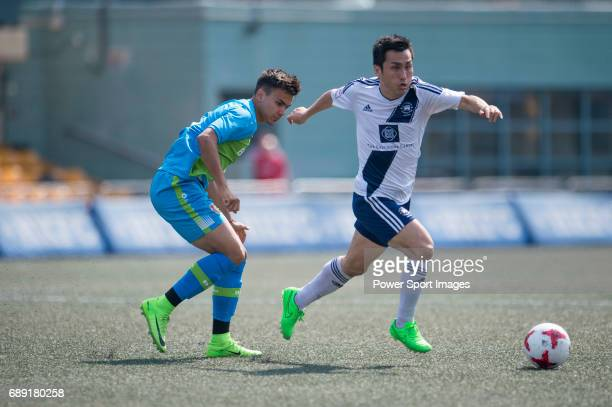 Bayer Leverkusen's Atakan Akkaynak competes with HKFC's Shunsuke Nakamura for a ball during their Main Tournament Plate QuarterFinal match part of...