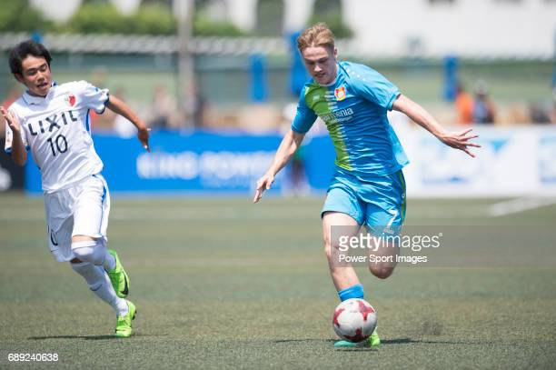 Bayer Leverkusen's Atakan Akkaynak competes with Kashima Antlers' Shoichi Kurimata for a ball during their Main Tournament Plate SemiFinal match part...