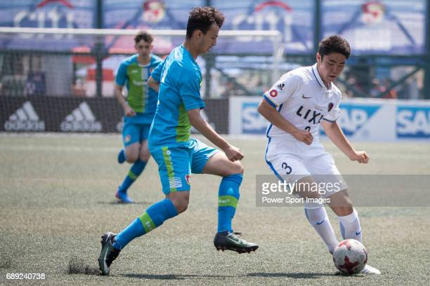 Bayer Leverkusen's Atakan Akkaynak competes with Kashima Antlers' Hiroki Tokoyoda for a ball during their Main Tournament Plate SemiFinal match part...