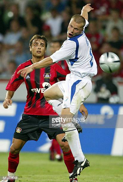 Bayer Leverkusen's Dimitar Berbatov vies for the ball against Banik Ostrava's Pavel Besta during their 1st leg match of the qualification round of...