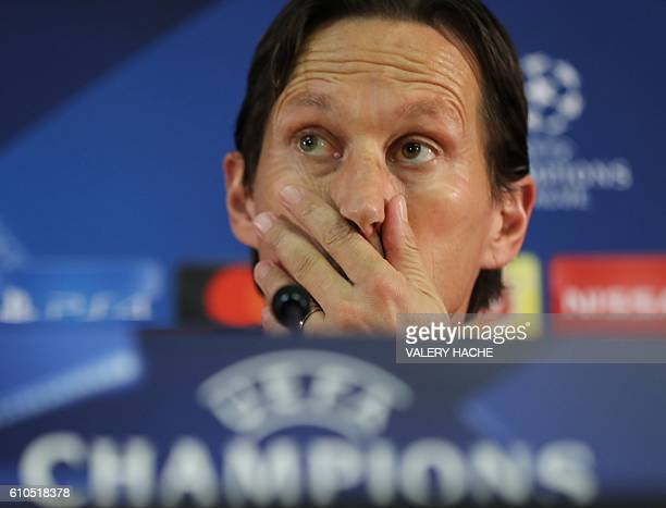 Bayer Leverkusen's football club head coach Roger Schmidt gestures as he gives a press conference on the eve of the UEFA Champions League football...