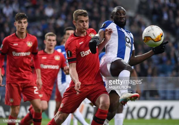 Bayer Leverkusen's German defender Lars Bender vies with FC Porto's Malian forward Moussa Marega during the UEFA Europa League round of 32 second leg...