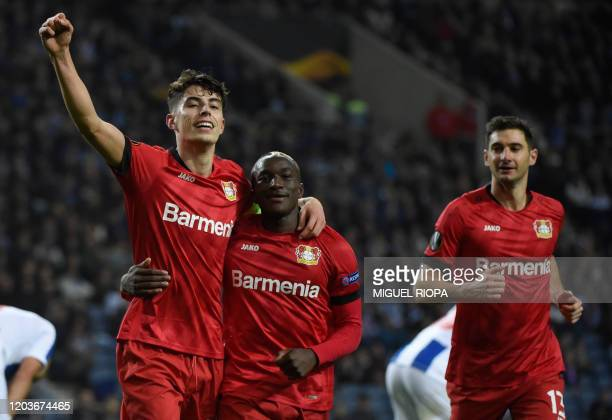 Bayer Leverkusen's German midfielder Kai Havertz celebrates with teammate French forward Moussa Diaby and Argentine forward Lucas Alario after...