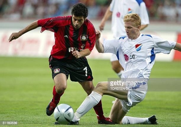 Bayer Leverkusen's Robson Ponte vies for the ball against Banik Ostrava's Josef Dvornik during their 1st leg match of the qualification round of the...