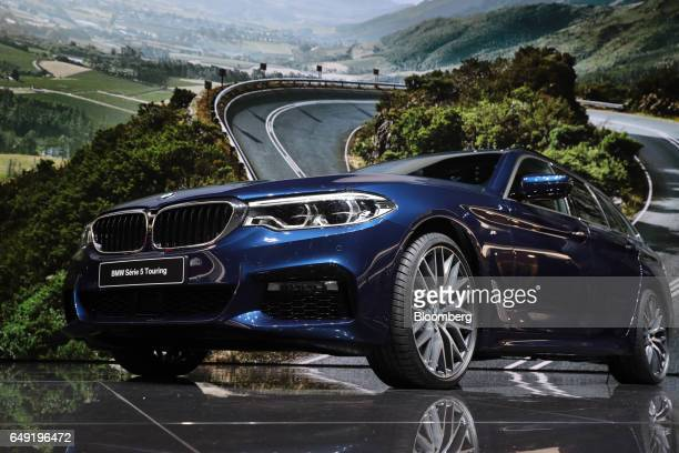A Bayerische Motoren Werke AG 5 Series Touring automobile stands on display on the first day of the 87th Geneva International Motor Show in Geneva...