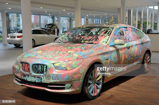 Bayerische Motoren Werke AG 5-Series 550 GT automobile covered in fingerpaint is seen on display at a BMW dealership in Munich, Germany, on Monday,...