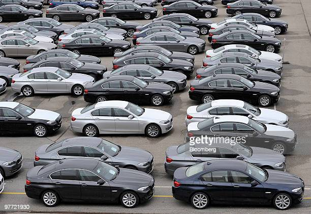 Bayerische Motoren Werke AG 5series automobiles await export from the company's factory in Dingolfing Germany on Monday March 15 2010 Bayerische...