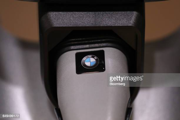 A Bayerische Motoren Werke AG branded electric vehicle charge plug sits on display on the second day of the 87th Geneva International Motor Show in...