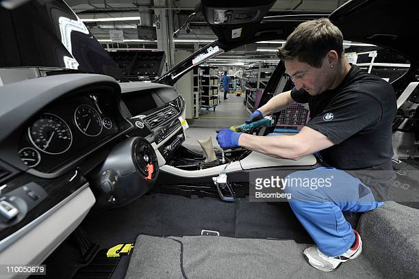 A Bayerische Motoren Werke AG employee assembles a BMW 6 Series cabriolet automobile at the company's factory in Dingolfing Germany on Monday March...