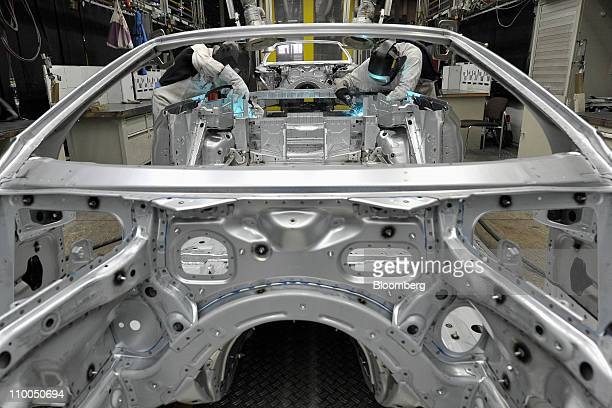 Bayerische Motoren Werke AG employees weld body parts on a BMW 6 Series cabriolet automobile at the company's factory in Dingolfing Germany on Monday...