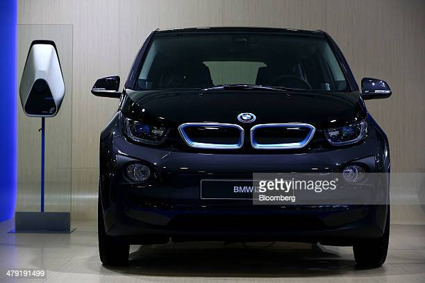 A Bayerische Motoren Werke AG i3 electric vehicle sits on display at the first International Electric Vehicle Expo in Seogwipo Jeju South Korea on...