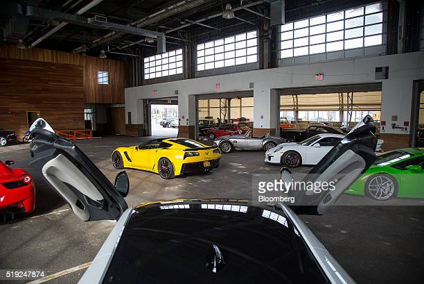 Bayerische Motoren Werke AG i8 bottom center and 2015 Chevrolet Corvette Z06 top center vehicles sit parked in the Classic Car Club's new location at...