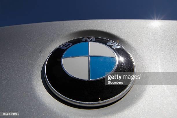 A Bayerische Motoren Werke AG logo is seen on a BMW 530d automobile near Walchsee Austria on Thursday Sept 2 2010 Bayerische Motoren Werke AG the...