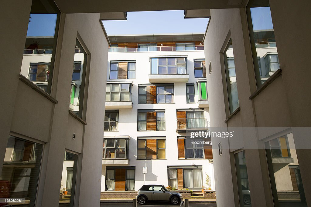 A Bayerische Motoren Werke AG (BMW) Mini automobile stands outside residential apartments at the Riverside Quarter development in the Wandsworth district of London, U.K., on Monday, March 4, 2013. Central London luxury-home prices unexpectedly rose at the fastest pace in 10 months in February as the British pound's depreciation helped attract international investors, Knight Frank LLP said. Photographer: Jason Alden/Bloomberg via Getty Images