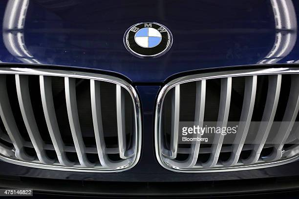 A Bayerische Motoren Werke AG roundel logo sits after being affixed to the hood of a vehicle during final inspection at the BMW Manufacturing Co...