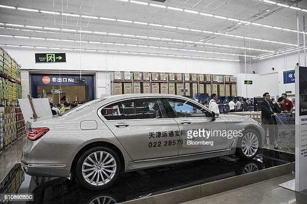 A Bayerische Motoren Werke AG sedan sits on display in a WalMart Stores Inc owned and operated Sam's Club store during its opening day in Tianjin...