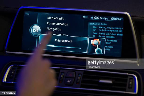 A Bayerische Motoren Werke AG touch screen is demonstrated during a news conference at the 2015 Consumer Electronics Show in Las Vegas Nevada US on...