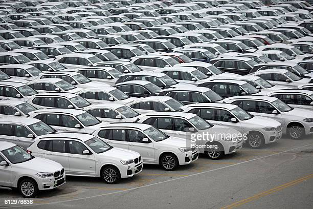 Bayerische Motoren Werke AG vehicles assembled in the US sit parked before being driven onto vehicle carrier ships at the Port of Charleston in...