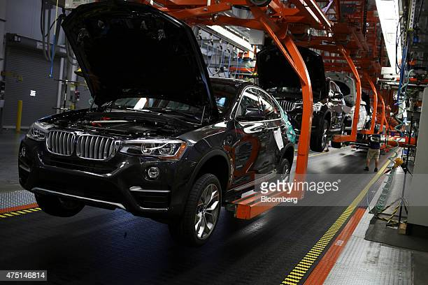 Bayerische Motoren Werke AG vehicles move down the assembly line at the BMW Manufacturing Co assembly plant in Greer South Carolina US on Thursday...