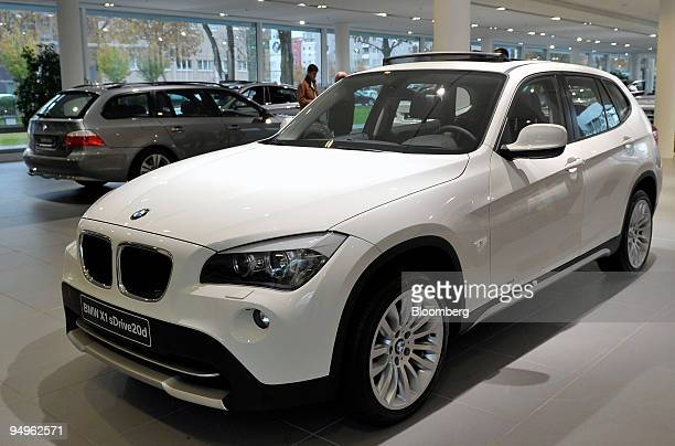 Bayerische Motoren Werke AG X1 automobile is seen on display at a BMW dealership in Munich Germany on Monday Nov 2 2009 The company releases its...