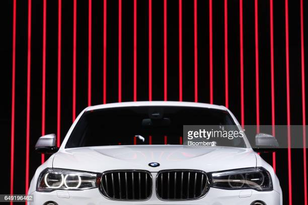 A Bayerische Motoren Werke AG X4 compact crossover vehicle stands on display on the first day of the 87th Geneva International Motor Show in Geneva...