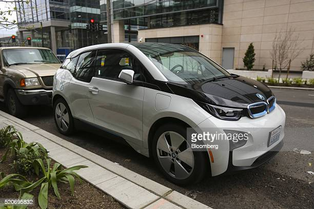 A Bayerische Motoren Werke AGb i3 electric vehicle part of the ReachNow carshare program sits parked in Seattle Washington US on Monday April 11 2016...