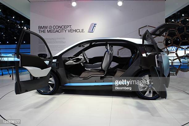 Bayerische Motoren Werke AG's i3 concept electric automobile sits on display during the Frankfurt Motor Show in Frankfurt Germany on Wednesday Sept...