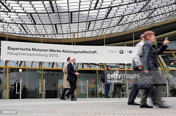Bayerische Motorenwerke shareholders leave the Olympia Hall site of the company's annual shareholders' meeting in Munich Germany on Tuesday May 18...
