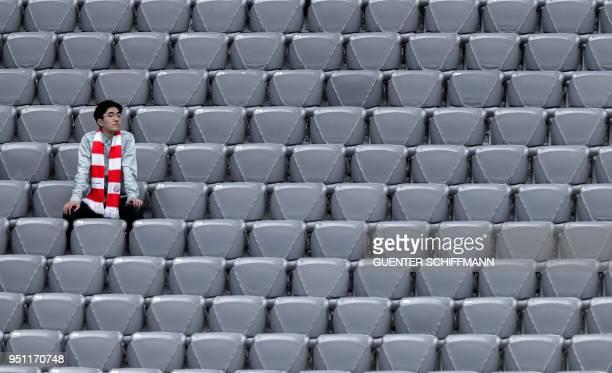Bayern fan waits for the kick off prior to the UEFA Champions League semifinal firstleg football match FC Bayern Munich v Real Madrid CF in Munich...