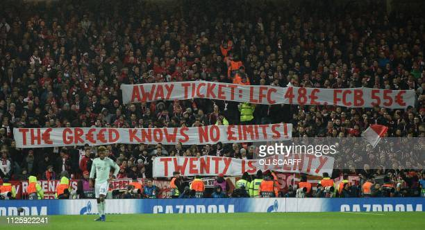 Bayern fans display placards complaining about ticket prices during the UEFA Champions League round of 16 first leg football match between Liverpool...