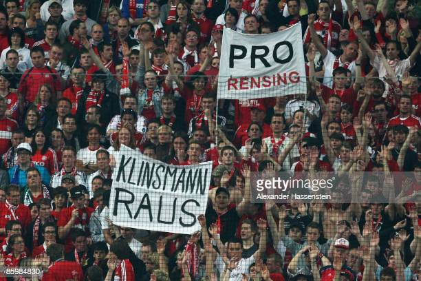 Bayern fans hold up banners pro goalkeeper Michael Rensing and contra head coach Juergen Klinsmann during the UEFA Champions League Quarter Final...