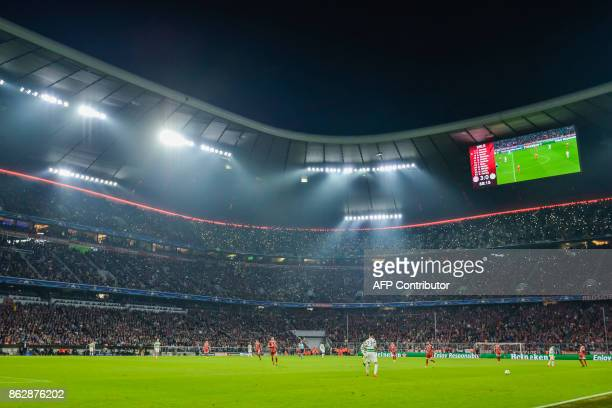 Bayern fans make their own light show during the Champions League group B match between FC Bayern Munich and Celtic Glasgow in Munich southern...