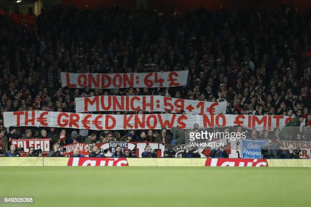 Bayern fans raise a banner to complain about the cost of match day tickets during the UEFA Champions League last 16 second leg football match between...