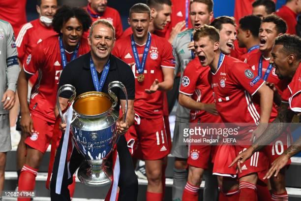 Bayern head Coach Hans-Dieter Flick lifts the European Cup after the UEFA Champions League final football match between Paris Saint-Germain and...
