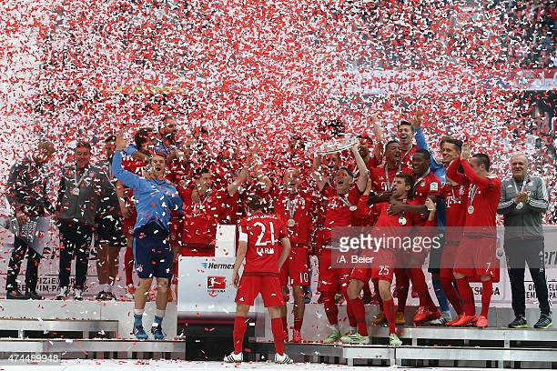 Bayern Muenchen celebrates winning the German Championship with the Bundesliga trophy after the Bundesliga match FC Bayern Muenchen and 1 FSV Mainz...