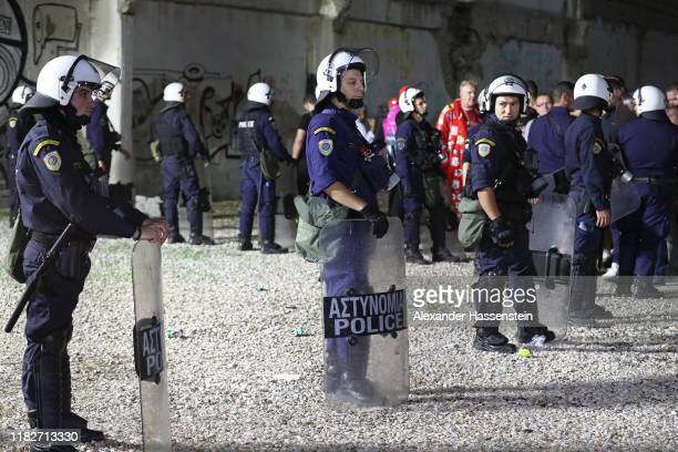 Bayern Muenchen fans are escorted to the stadium by police prior to the UEFA Champions League group B match between Olympiacos FC and Bayern Muenchen...