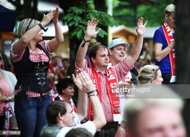 Bayern Muenchen fans celebrate winning the Bundesliga in the beer garden at the Paulaner am Nockherberg on May 12 2018 in Munich Germany