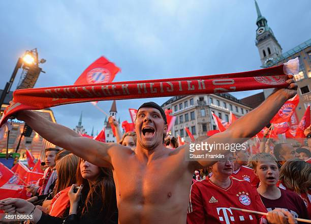 Bayern Muenchen fans wait for the players of FC Bayern Muenchen to celebrate at the Rathaus on May 10 2014 in Munich Germany