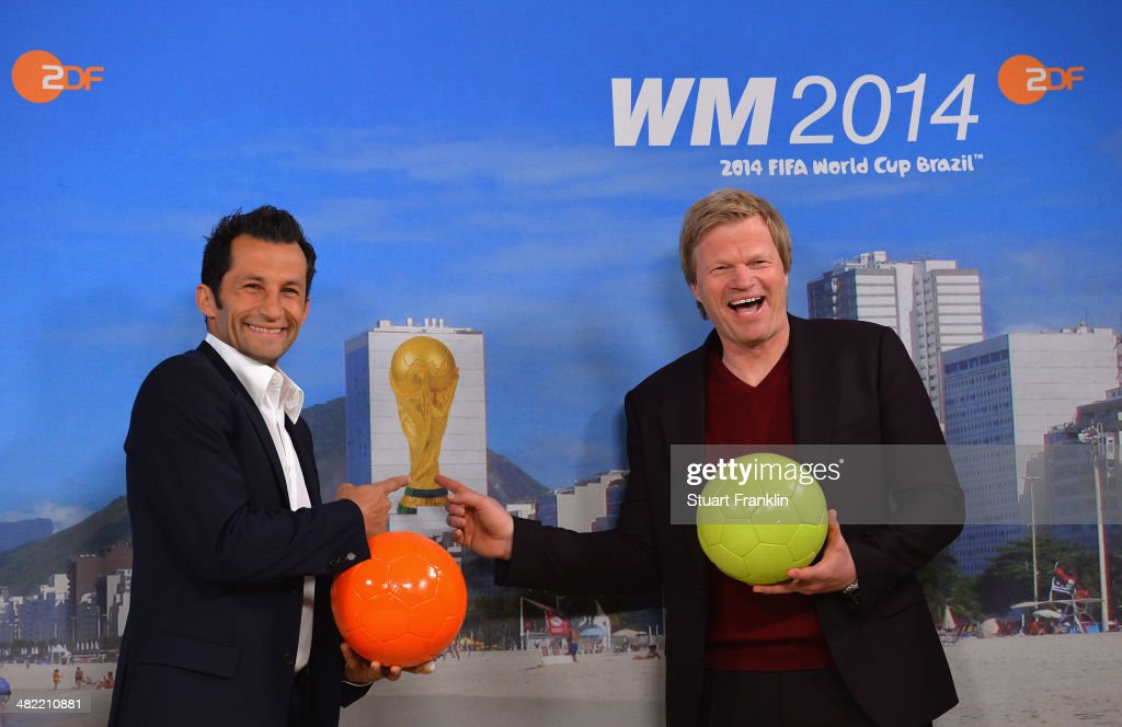 FC Bayern Muenchen football legends, Hasan Salihamidzic and Oliver Kahn are pictured during the ARD/ZDF FIFA World Cup 2014 team presentation event on April 3, 2014 in Hamburg, Germany.