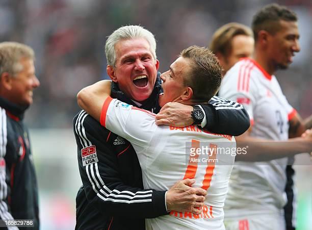 Bayern Muenchen head coach Jupp Heynckes celebrates with Xherdan Shaqiri after winning the Bundesliga after the match between Eintracht Frankfurt and...