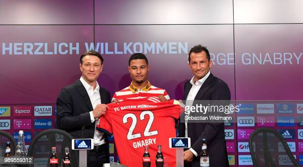 FC Bayern Muenchen head coach Niko Kovac new player Serge Gnabry and sports manager Hasan Salihamidzic present a FC bayern home jersey of Serge...