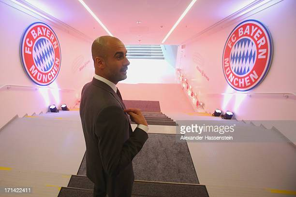 Bayern Muenchen new Head Coach Josep Guardiola walks at the players tunnel to the pitch inside the Allianz Arena on the day he is unveiled as...