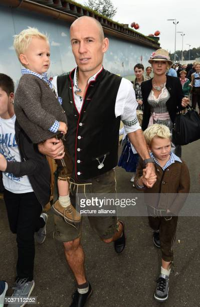 FC Bayern Muenchen player ArjenRobben his wife Bernadien and their kids leave the 'Kaeferzelt' during the 181st Oktoberfest in Munich Germany 05...