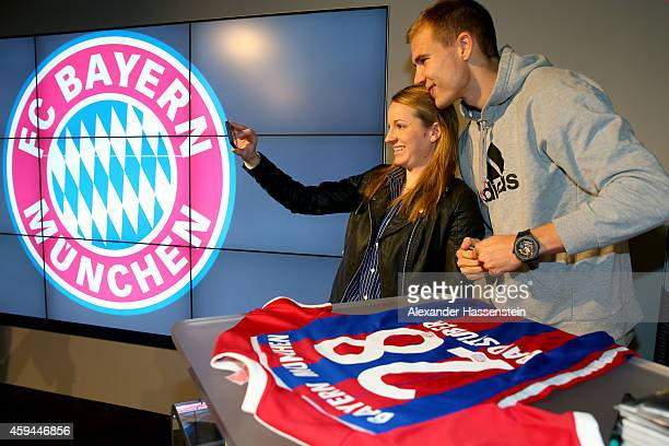 Bayern Muenchen player Holger Badstuber poses for pictures during his visit at the FC Bayern Erlebniswelt museum at Allianz Arena on November 23 2014...