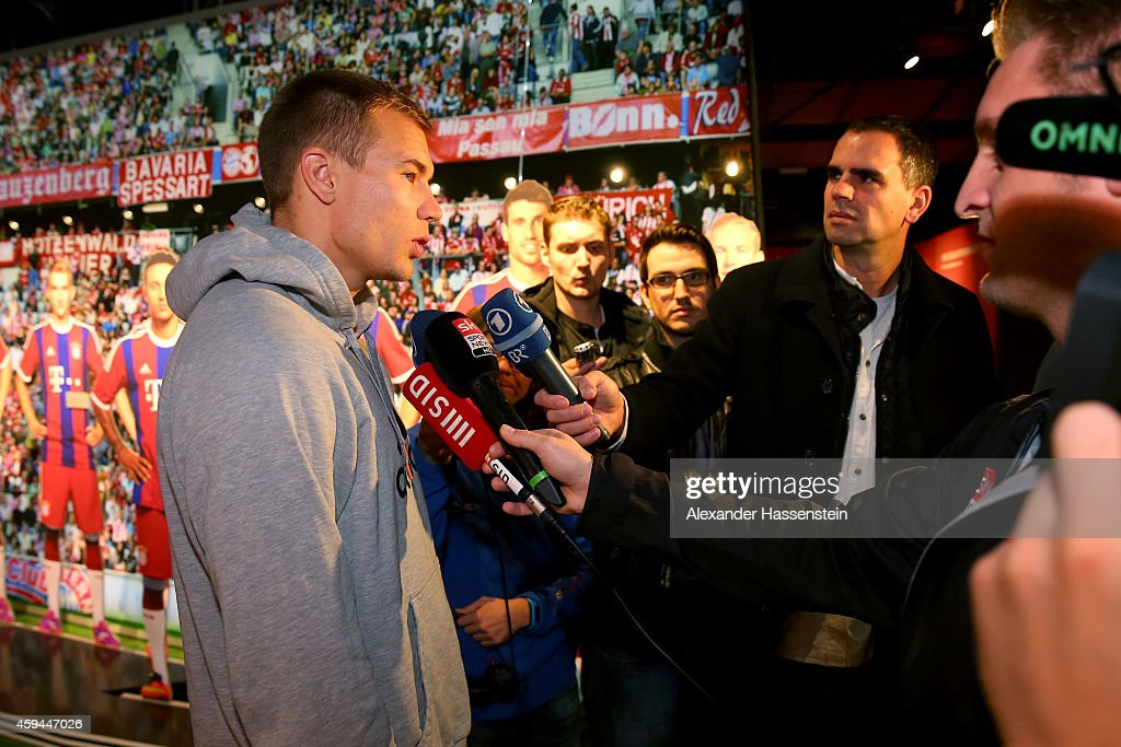 FC Bayern Muenchen player Holger Badstuber talks to the media during his visit at the FC Bayern Erlebniswelt museum at Allianz Arena on November 23, 2014 in Munich, Germany.