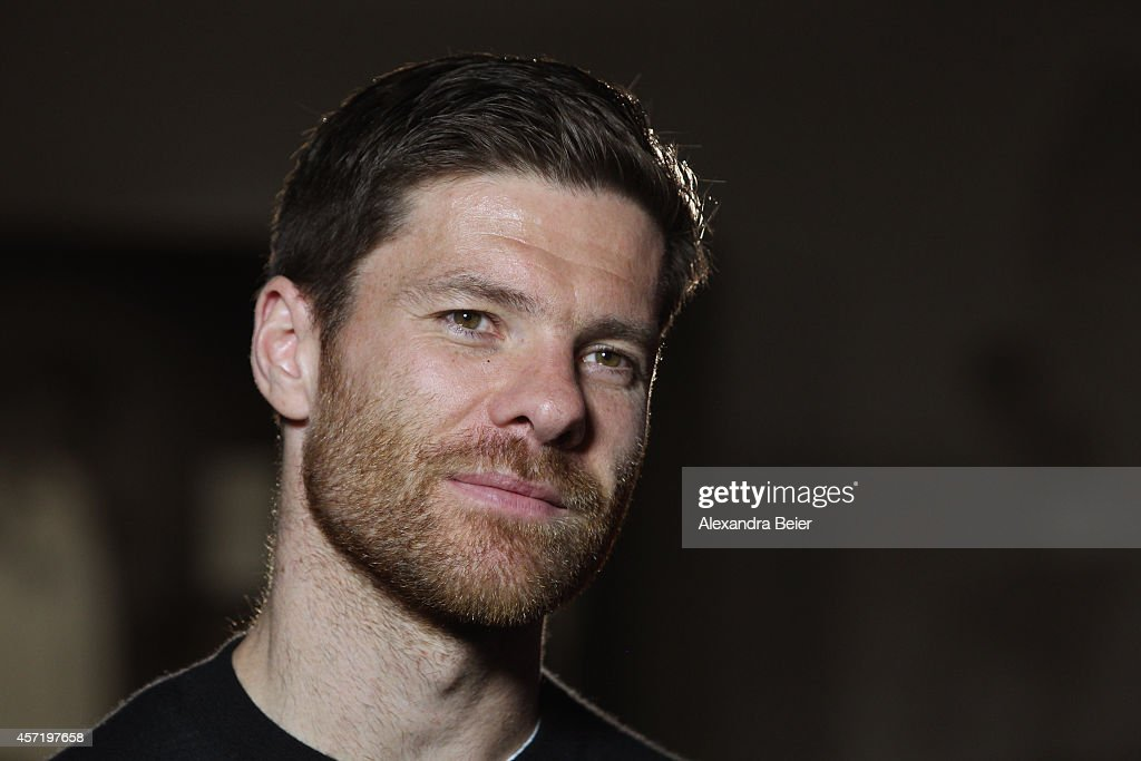 FC Bayern Muenchen player Xabi Alonso gives an interview during his visit at the FC Bayern Erlebniswelt museum at Allianz Arena on October 14, 2014 in Munich, Germany.