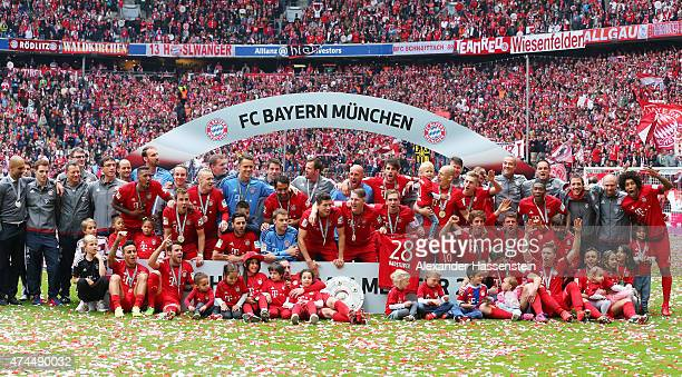 Bayern Muenchen players and staff celebrate with the trophy following the Bundesliga match between FC Bayern Muenchen and 1 FSV Mainz 05 at the...