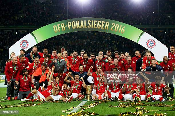 Bayern Muenchen players and team pose for a photo after winning the DFB Cup final match in a penalty shootout against Borussia Dortmund at...