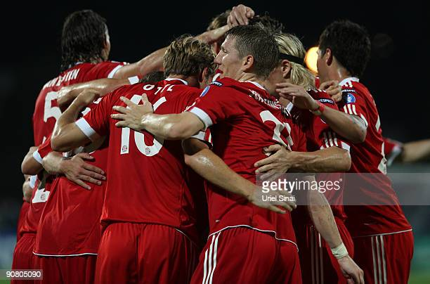 Bayern Muenchen players celebrate during the UEFA Champions League Group A match between Maccabi Haifa and FC Bayern Muenchen at Ramat Gan Stadium on...